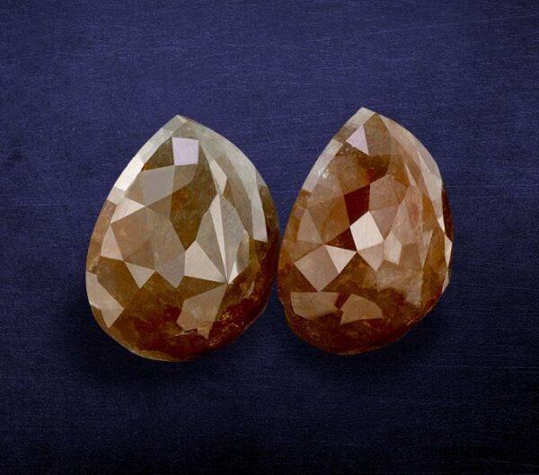 reddish color pear shape rustic diamond ICY