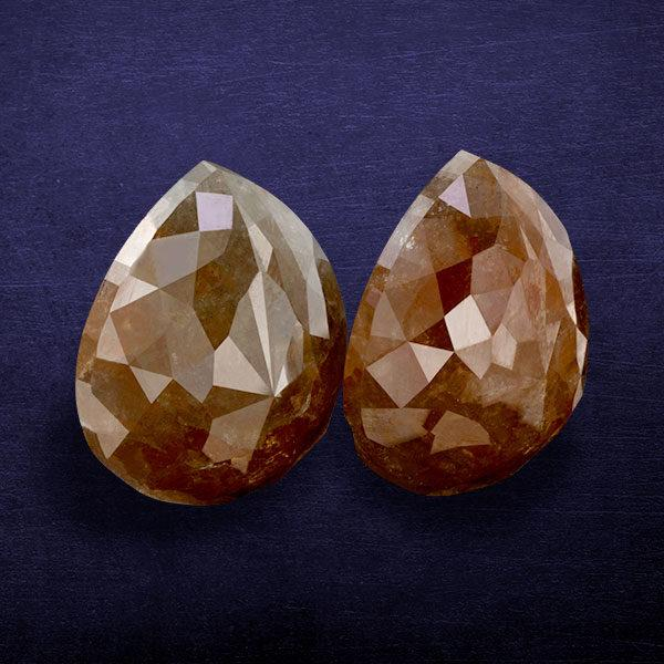 reddish color pear shape rustic diamond ICY