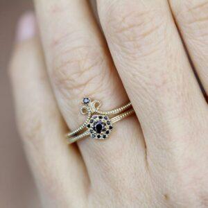 Black diamond hexagon shape ring in finger
