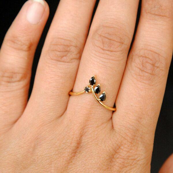 black diamond leaf ring on finger