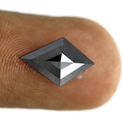 Kite black diamond on finger