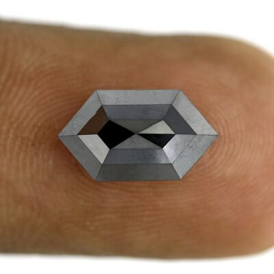 Elongated hexagon black diamond on finger