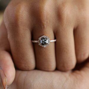 black diamond rose gold ring in finger
